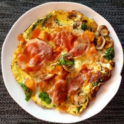 2 eggs, spinach, mushrooms, mozzarella cheese, and prosciutto